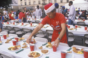Person volunteering by serving food on Christmas