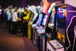 Arcade games standing side by side in an arcade