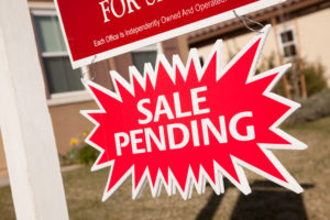 Sale Pending sign under a For Sale sign for real estate