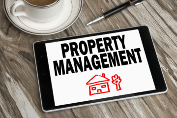 Tablet with Property Management text on screen