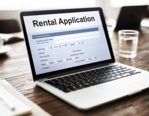 Laptop with online rental application on screen