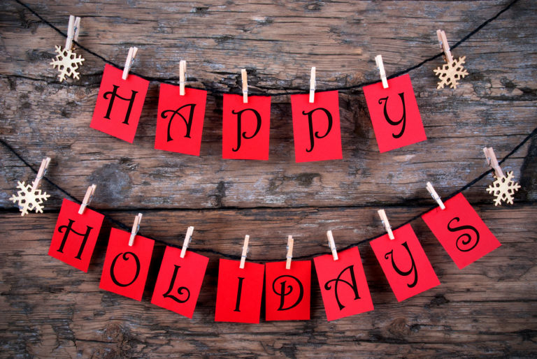 happy holidays spelled out in red letter hanging from a clothesline