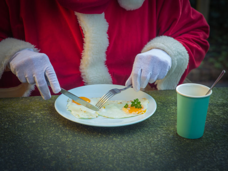 Breakfast of Santa Claus with fried egg in the garden. Christmas Morning
