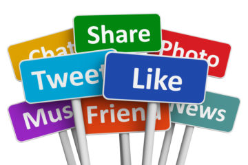 signs with social media phrases like share tweet friend photo