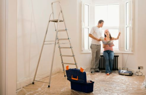 Home Renovations Image - Couple looking at paint samples