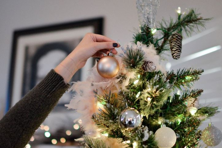 decorating christmas tree after buying home during holidays
