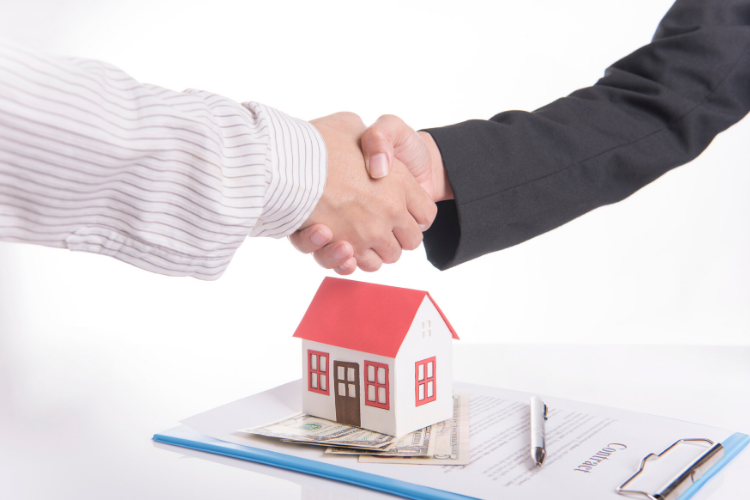 home warranty - shaking hands over contract